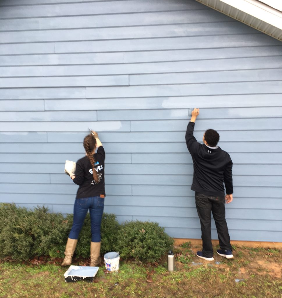 KMS Gives painting Habitat for Humanity House